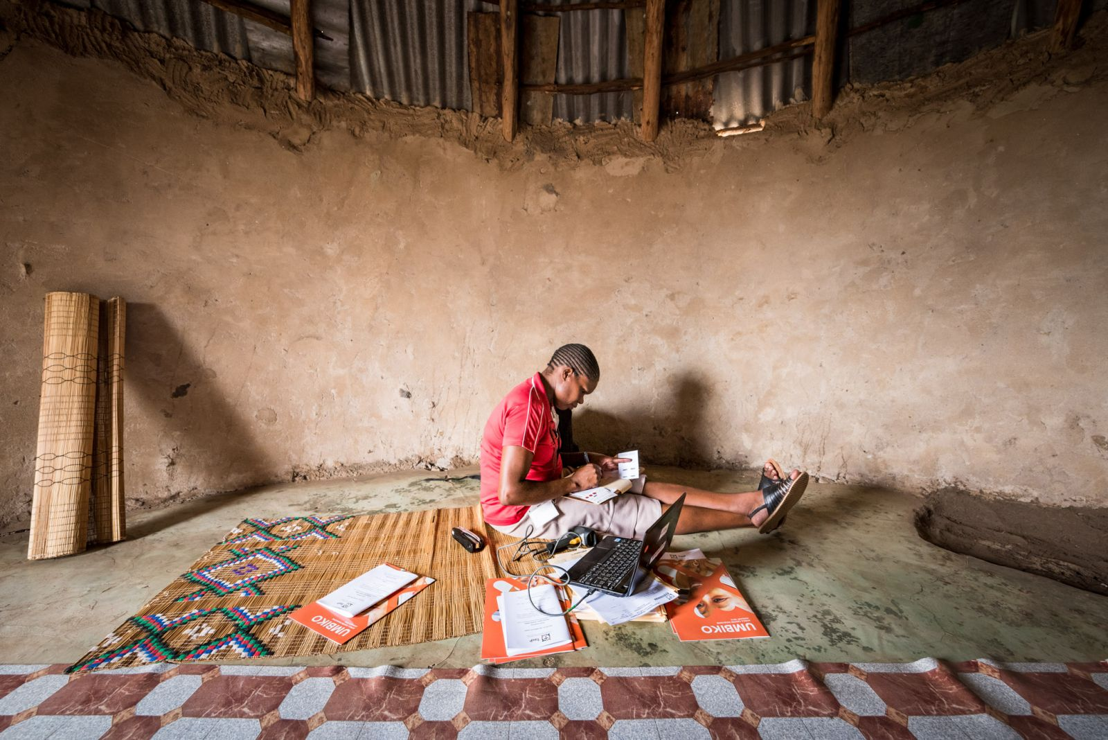Africa Health Research Institute fieldworker Philile Mcambi captures data at a home in northern KwaZulu-Natal.