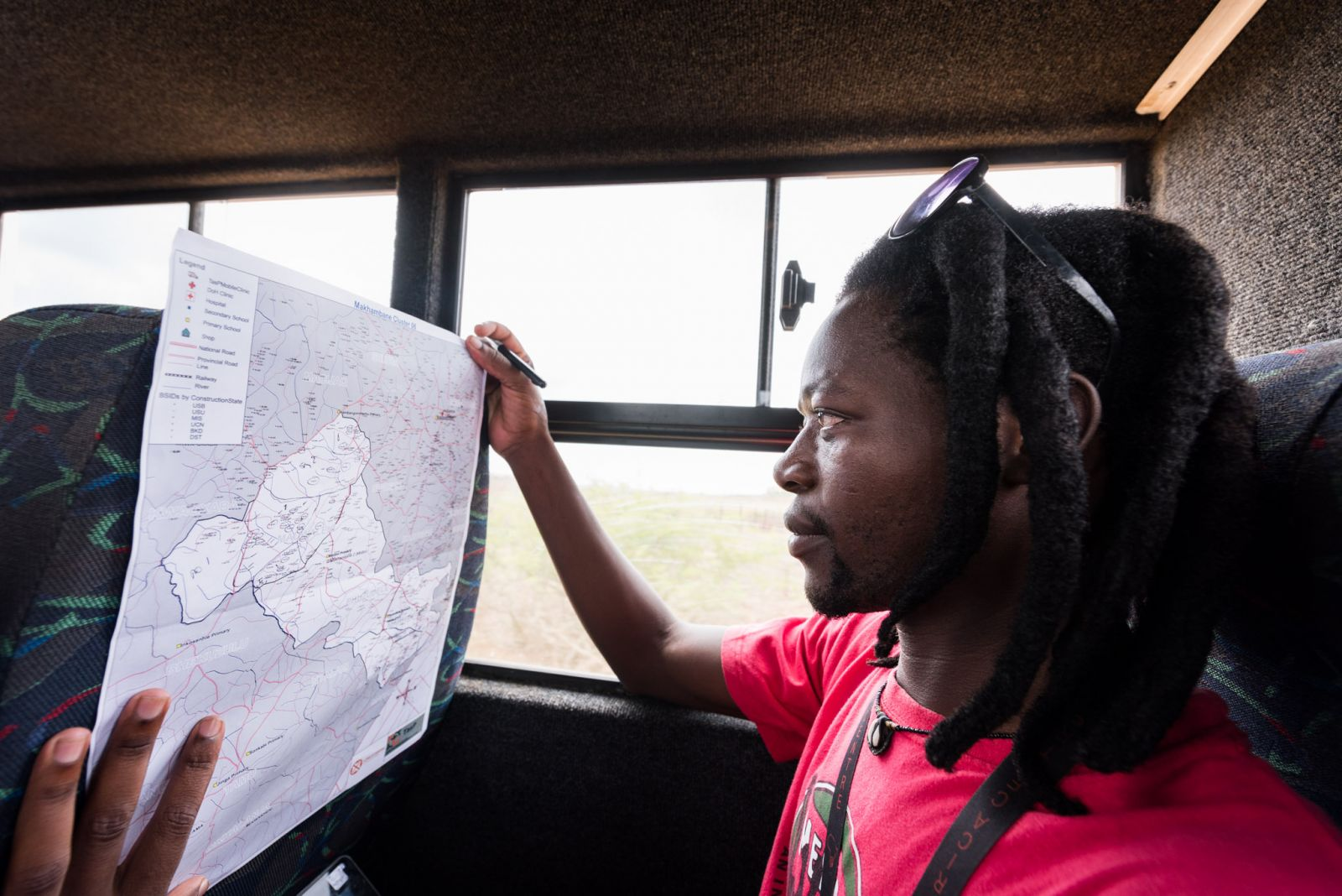 Jabulani Sibiya studies a map of households that make up the Africa Health Research Institute's population research area.